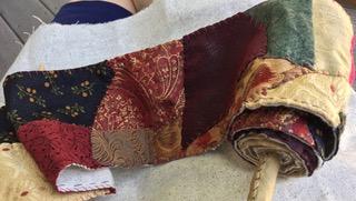 Bonnie A. Berkowitz_Scroll for Lady of Shallot_ varieties of precious fabrics_ in progress_ 5_ x 4_ x 38_